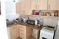 2 BEDROOM GROUND FLOOR APARTMENT IN PARALIMNI WITH LARGE YARD AND WITH TITLE DEEDS